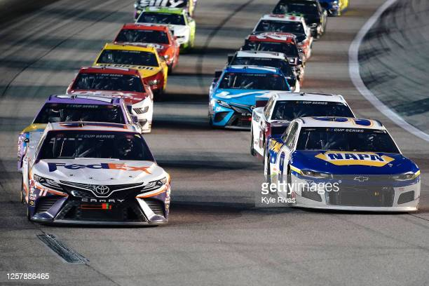 Denny Hamlin, driver of the FedEx Office Toyota, and Chase Elliott, driver of the NAPA Auto Parts Chevrolet, lead the field during a restart of the...