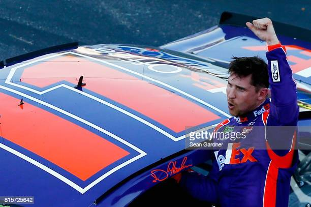 Denny Hamlin driver of the FedEx Office Toyota celebrates after winning the Monster Energy NASCAR Cup Series Overton's 301 at New Hampshire Motor...