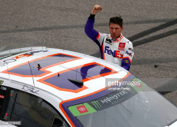 Denny Hamlin, driver of the FedEx Office Toyota, celebrates his victory after the Monster Energy NASCAR Cup Series Hollywood Casino 400 at Kansas...