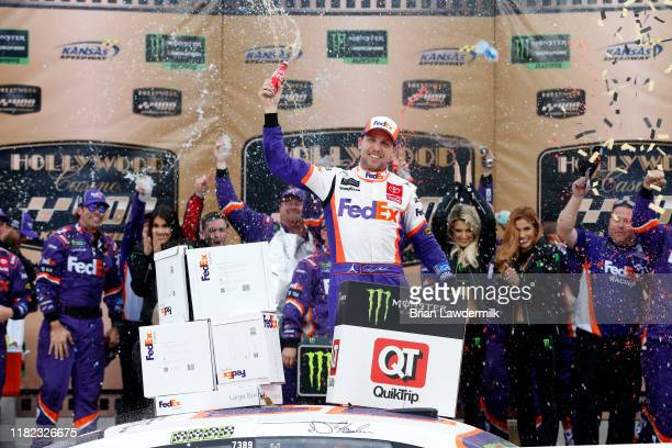 Denny Hamlin, driver of the FedEx Office Toyota, celebrates in Victory Lane after winning the Monster Energy NASCAR Cup Series Hollywood Casino 400...