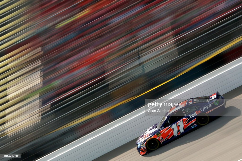 Denny Hamlin, driver of the #11 FedEx Office Toyota, drives during qualifying for the Monster Energy NASCAR Cup Series Consmers Energy 400 at Michigan International Speedway on August 10, 2018 in Brooklyn, Michigan.