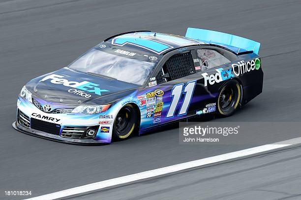 Denny Hamlin driver of the FedEx Office Toyota during practice for the NASCAR Sprint Cup Series CocaCola 600 at Charlotte Motor Speedway on May 23...