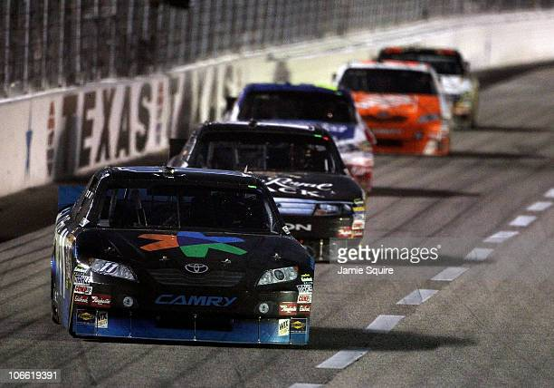 Denny Hamlin driver of the FedEx Office Toyota leads Matt Kenseth driver of the Crown Royal Black Ford and Mark Martin driver of the...