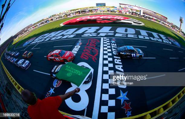 Denny Hamlin driver of the FedEx Office Toyota leads the field to the green flag to start the NASCAR Sprint Cup Series CocaCola 600 at Charlotte...