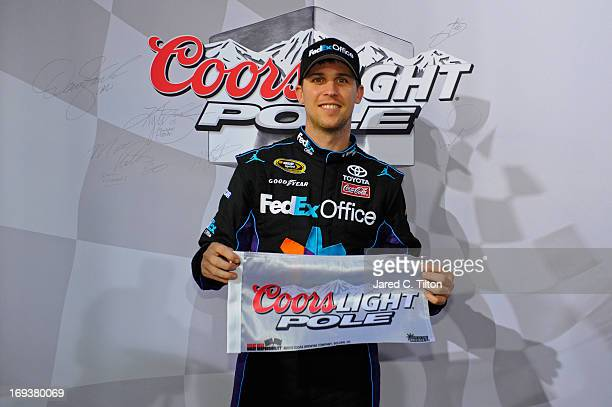 Denny Hamlin driver of the FedEx Office Toyota poses in Victory Lane after qualifying for the pole position in the NASCAR Sprint Cup Series CocaCola...