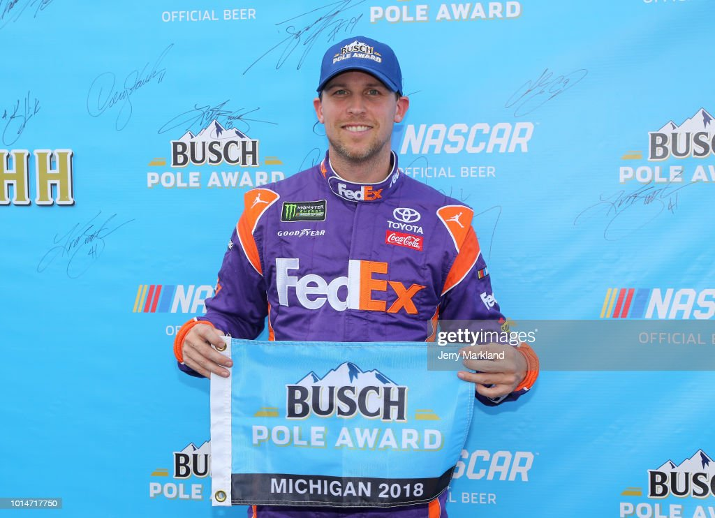 Denny Hamlin, driver of the #11 FedEx Office Toyota, poses with the pole award after qualifying for the Monster Energy NASCAR Cup Series Consmers Energy 400 at Michigan International Speedway on August 10, 2018 in Brooklyn, Michigan.