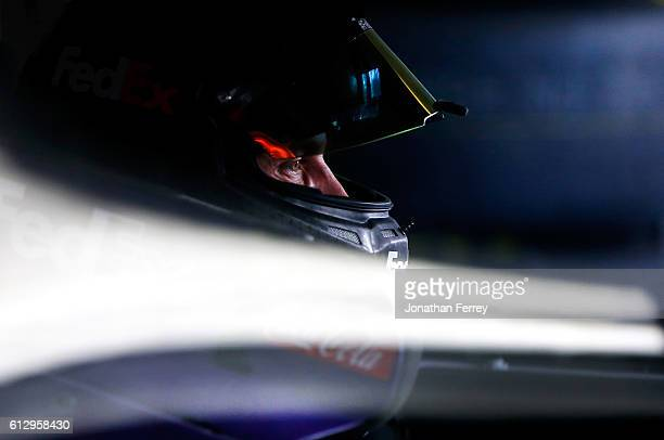 Denny Hamlin driver of the FedEx Office Toyota sits in his car during practice for the NASCAR Sprint Cup Series Bank of America 500 at Charlotte...