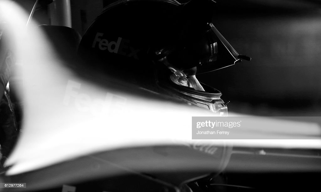 Denny Hamlin, driver of the #11 FedEx Office Toyota, sits in his car during practice for the NASCAR Sprint Cup Series Bank of America 500 at Charlotte Motor Speedway on October 6, 2016 in Charlotte, North Carolina.