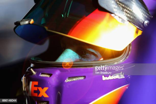 Denny Hamlin driver of the FedEx Office Toyota sits in his car during practice for the Monster Energy NASCAR Cup Series O'Reilly Auto Parts 500 at...