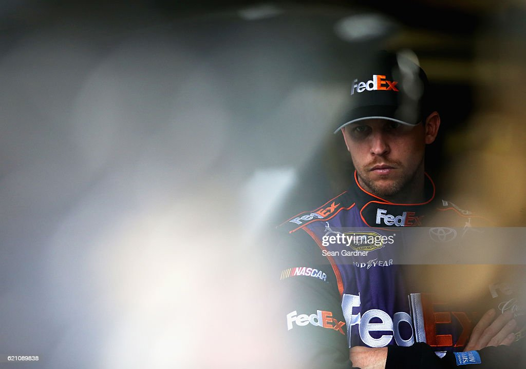 Denny Hamlin, driver of the #11 FedEx Office Toyota, stands in the garage area during practice for the NASCAR Sprint Cup Series AAA Texas 500 at Texas Motor Speedway on November 4, 2016 in Fort Worth, Texas.