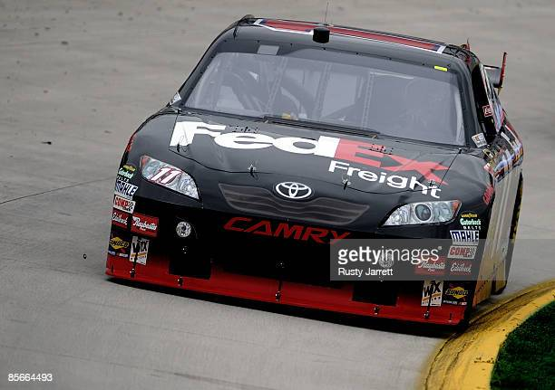 Denny Hamlin driver of the FedEx Toyota drives against the curb during practice for the NASCAR Sprint Cup Series Goody�s Fast Pain Relief 500 at the...
