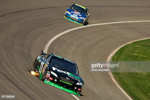 Denny Hamlin driver of the FedEx Toyota leads Jeff Gordon driver of the DuPont/Pepsi Chevrolet during the NASCAR Sprint Cup Series Pepsi 500 at Auto...