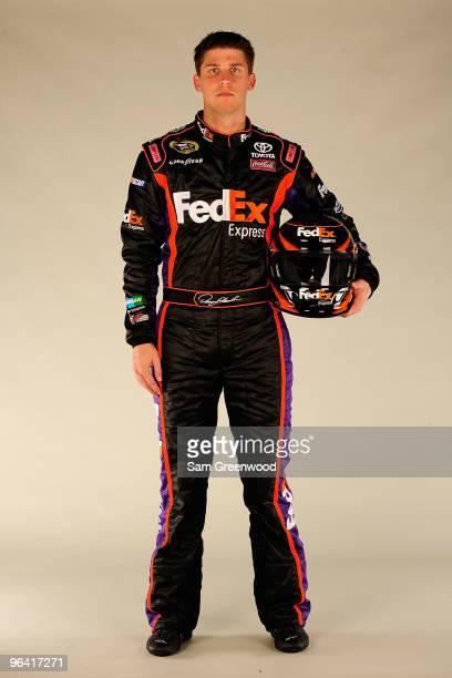 Denny Hamlin driver of the FedEx Toyota poses during NASCAR media day at Daytona International Speedway on February 4 2010 in Daytona Beach Florida