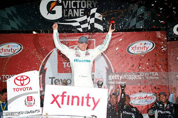 Denny Hamlin driver of the Hisense Toyota celebrates in Victory Lane after winning the NASCAR XFINITY Series ToyotaCare 250 at Richmond International...