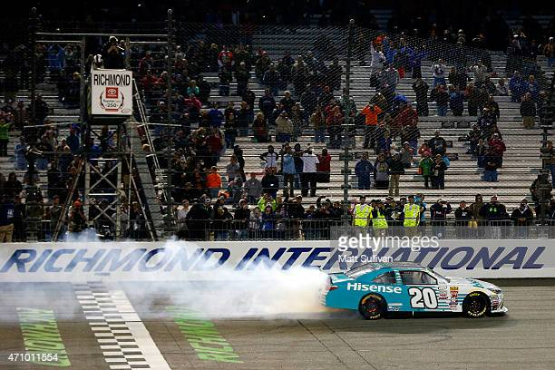 Denny Hamlin driver of the Hisense Toyota celebrates with a burnout after winning the NASCAR XFINITY Series ToyotaCare 250 at Richmond International...