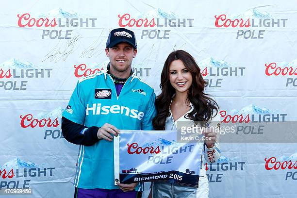 Denny Hamlin driver of the Hisense Toyota celebrates with Miss Coors Light Amanda Mertz after winning the Coors Light Pole Award during qualifying...