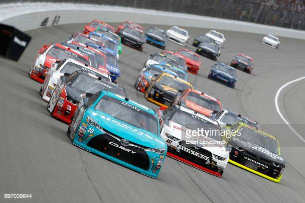 Denny Hamlin driver of the Hisense Toyota leads a pack of cars during the NASCAR XFINITY Series Irish Hills 250 at Michigan International Speedway on...