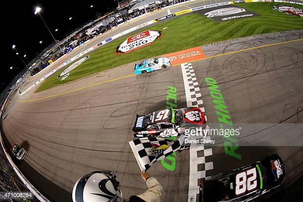 Denny Hamlin driver of the Hisense Toyota takes the checkered flag to win the NASCAR XFINITY Series ToyotaCare 250 at Richmond International Raceway...