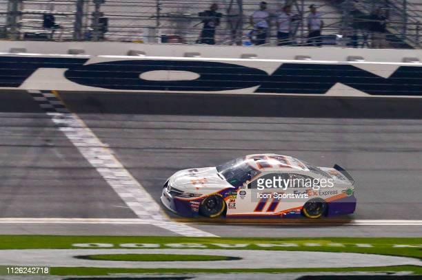 Denny Hamlin driver of the Joe Gibbs Racing FedEx Express Toyota Camry crossed the start/finish line during the Daytona 500 on February 17 2019 at...