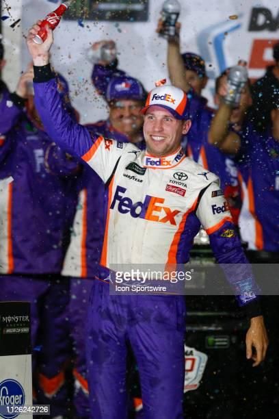 Denny Hamlin driver of the Joe Gibbs Racing FedEx Express Toyota Camry celebrates the win in the Daytona 500 on February 17 2019 at Daytona...
