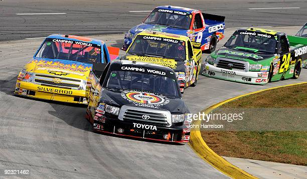 Denny Hamlin driver of the Miccosukee Resort Toyota leads a group of trucks during the NASCAR Camping World Truck Series Kroger 200 at Martinsville...