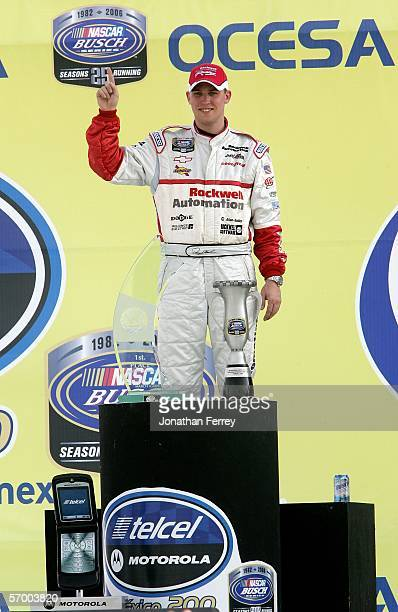 Denny Hamlin driver of the Rockwell Automation Chevrolet poses with the trophy after winning the NASCAR Busch Series Telcel-Motorola 200 on March 5,...