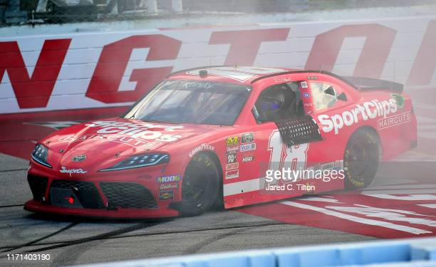 Denny Hamlin, driver of the Sport Clips Toyota, celebrates after winning the NASCAR Xfinity Series Sport Clips Haircuts VFW 200 at Darlington Raceway...