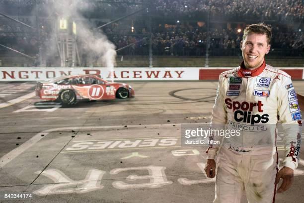 Denny Hamlin driver of the Sport Clips Toyota celebrates winning the Monster Energy NASCAR Cup Series Bojangles' Southern 500 at Darlington Raceway...