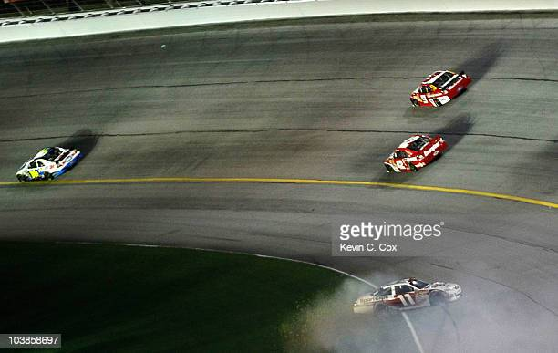 Denny Hamlin driver of the Sport Clips Toyota spins out after an incident in the NASCAR Sprint Cup Series Emory Healthcare 500 at Atlanta Motor...