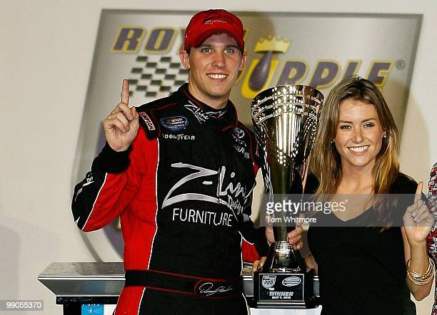 Denny Hamlin driver of the ZLine Designs / Operations Helmet Toyota celebrates with his girlfriend Jordan Fish in victoory lane after Hamlin won the...