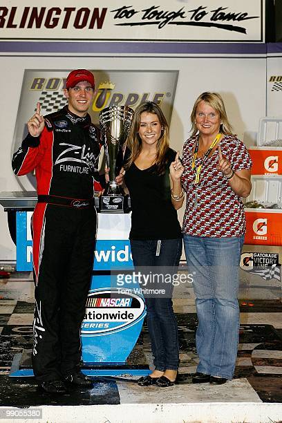 Denny Hamlin driver of the ZLine Designs / Operations Helmet Toyota celebrates with his girlfriend Jordan Fish and mother Mary Lou in victoory lane...