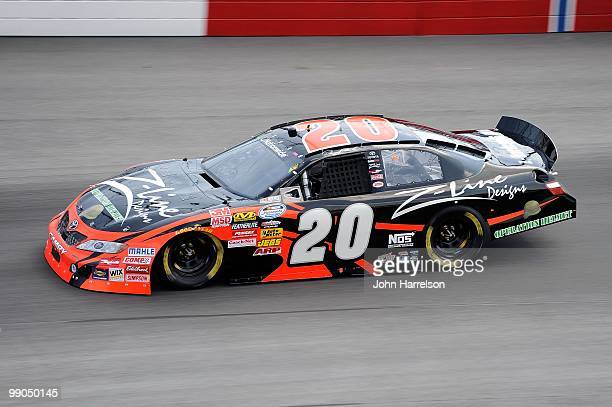 Denny Hamlin driver of the ZLine Designs/Operation Helmet Toyota drives on track during qualifying for the NASCAR Nationwide series Royal Purple 200...