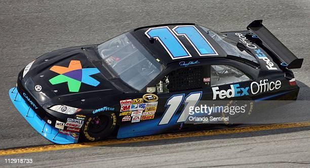 Denny Hamlin drives his Nextel Sprint Cup car during qualifying for the Coke Zero 400 at Daytona International Speedway in Daytona Beach, Florida,...