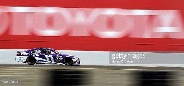 Denny Hamlin drives the FedEx Cares Toyota during the NASCAR Sprint Cup Series Toyota/Save Mart 350 at Sonoma Raceway on June 26 2016 in Sonoma...