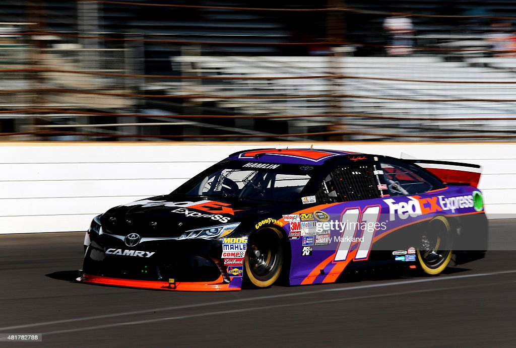 Denny Hamlin drives the #11 FedEx Express Toyota during practice for the NASCAR Sprint Cup Series Crown Royal Presents the Jeff Kyle 400 at the Brickyard at Indianapolis Motorspeedway on July 24, 2015 in Indianapolis, Indiana.