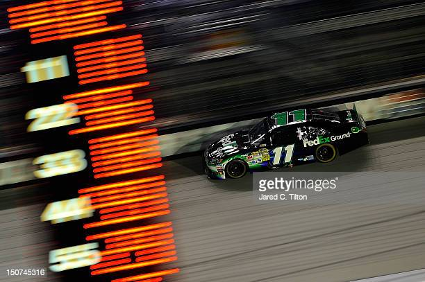 Denny Hamlin drives the FedEx Ground Toyota during the NASCAR Sprint Cup Series IRWIN Tools Night Race at Bristol Motor Speedway on August 25 2012 in...