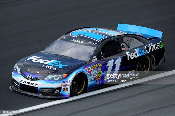 Denny Hamlin drives the FedEx Office Toyota during practice for the NASCAR Sprint Cup Series CocaCola 600 at Charlotte Motor Speedway on May 23 2013...