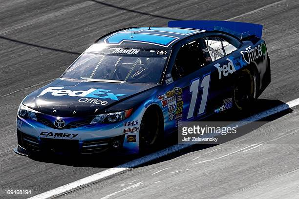 Denny Hamlin drives the FedEx Office Toyota during practice for the NASCAR Sprint Cup Series CocaCola 600 at Charlotte Motor Speedway on May 25 2013...