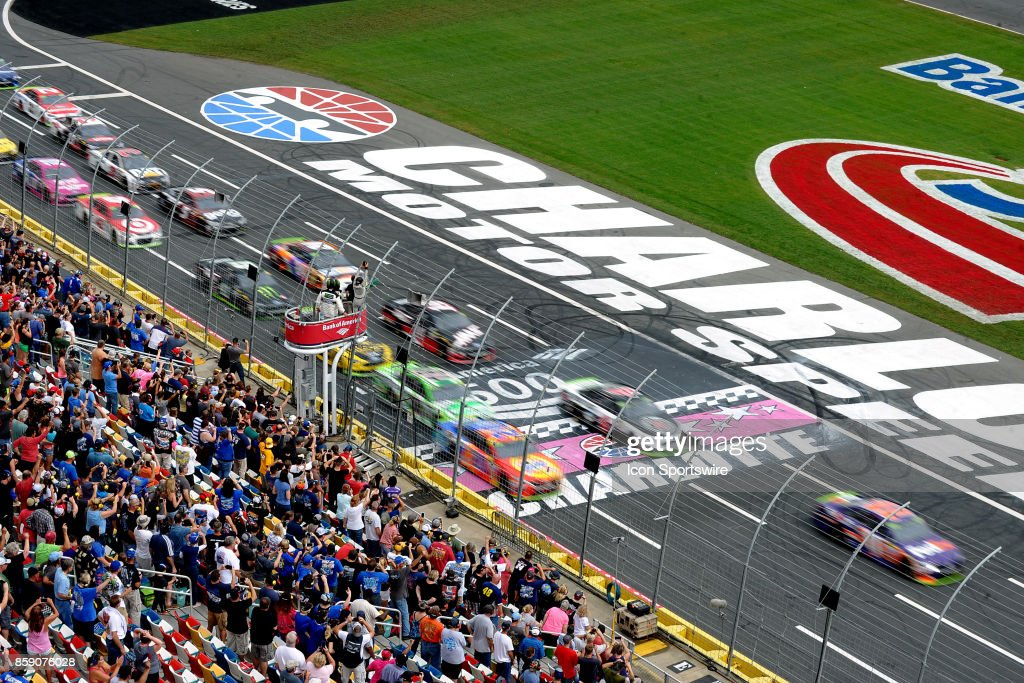 Denny Hamlin, Joe Gibbs Racing, FedEx Office Toyota Camry (11) leads the field across the start finish as the green flag drops to start the Monster Energy NASCAR Cup Series Bank of America 500 on October 08,2017, at Charlotte Motor Speedway in Concord,NC.
