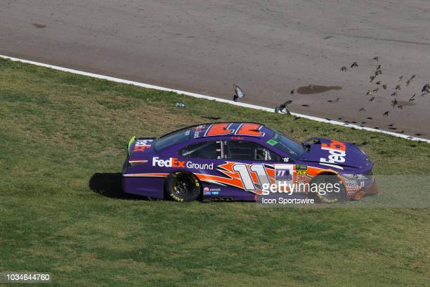 Denny Hamlin Joe Gibbs Racing Toyota Camry crashes in the infield during the inaugural South Point 400 Monster Energy NASCAR Cup Series race on...
