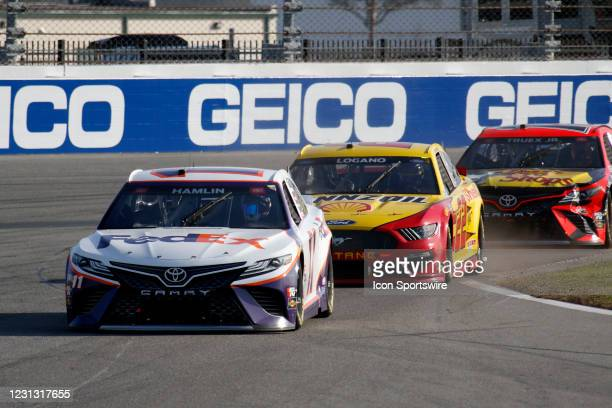 Denny Hamlin, Joe Gibbs Racing, Toyota Camry FedEx Express, #22: Joey Logano, Team Penske, Ford Mustang Shell Pennzoil during the running of the...