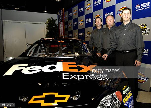 Denny Hamlin with team president JD Gibbs and vice president Jimmy Makar announce Hamlin as the driver of the FedEx Chevrolet during a press...