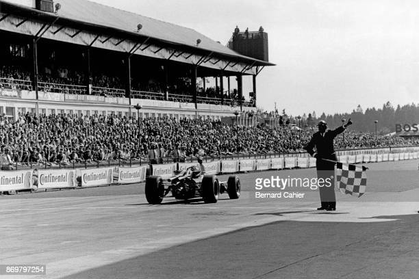 Denny Hulme BrabhamRepco BT24 Grand Prix of Germany Nurburgring 06 August 1967 Denny Hulme takes the checkered flag and wins the 1967 Grand Prix of...