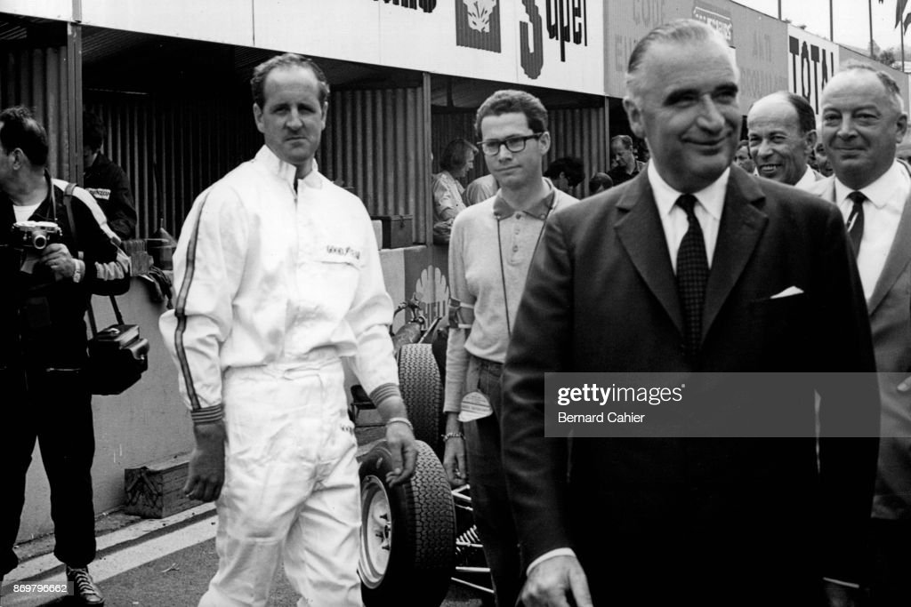 Denny Hulme, George Pompidou, Jabby Crombac, Grand Prix of France, Reims-Gueux, 03 July 1966. French Prime Minister and future President George Pompidou visiting the 1966 Grand Prix of France in Reims.