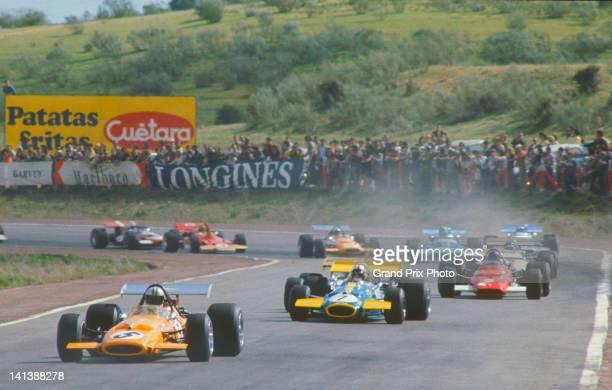 Denny Hulme of New Zealand driving the Bruce McLaren Motor Racing McLaren M14A Ford V8 leads Jack Brabham in the Brabham Racing Organisation Brabham...