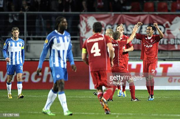 Denny Landzaat of FC Twente celebrates with team-mates after scoring during the UEFA Europa League match between FC Twente and Odense BK at the...
