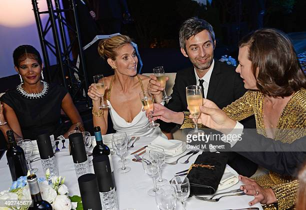 Denny Mendez Heidi Klum guest and Milla Jovovich attend the welcome party for Puerto Azul Experience Night at Villa St George on May 21 2014 in...