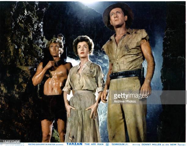Denny Miller Joanna Barnes and Robert Douglas explore a cave in a scene from the film 'Tarzan The Ape Man' 1959