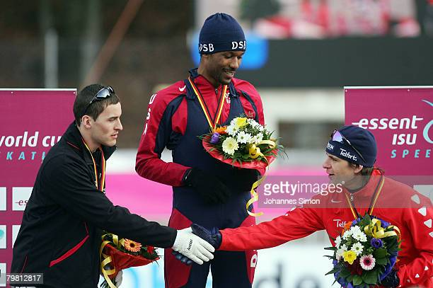 Denny Morrison of Canada Shani Davis of the USA and Jan Bos of the Netherlands celebrate after the 1000m heats during Day 2 of the Essent ISU Speed...