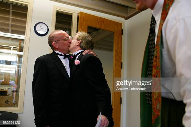 Denny Schrock and Patrick Phillips Schrock kiss after being legally married in their pastor's office at a local Unitarian church Earlier in the day...